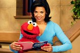Elmo and actress and author Sonia Manzano, who played the popular character María on Sesame Street.