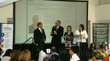 Jonathon Romero receives the Gerald J. Meyer Transfer Scholarship Award. from Dr. Meyer, Ms. Santos and Dr. Rivera