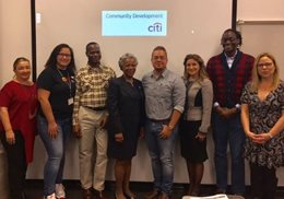 "Hostos students received a free ""Financial Literacy Empowerment Workshop""  thanks to a partnership with Citi Community Development. Two Citi representatives, Lily López and Pat Edwards.5 women. 3 men."