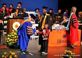 Hostos President David Gomez. Toddler. Graduate with Cap and Gown.