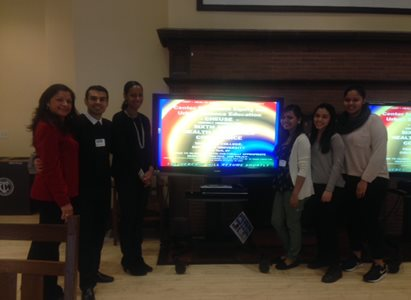 group gathered around a television.