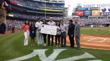 Honorees and students at Yankees Stadium.
