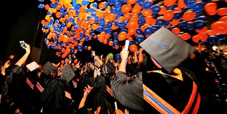 Hostos Graduates. Caps and Gowns. Blue and Orange balloons.