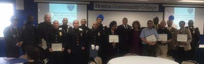 Group gathered to honor Officers. awards. certificates.